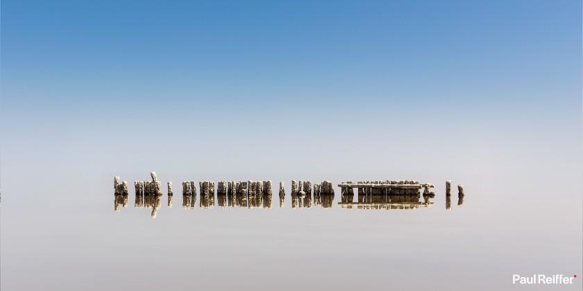 "Location : Salton Sea, USA <a href=""https://www.paulreiffer.com/buy-prints/no-horizon/"">- Buy the limited edition print</a>"
