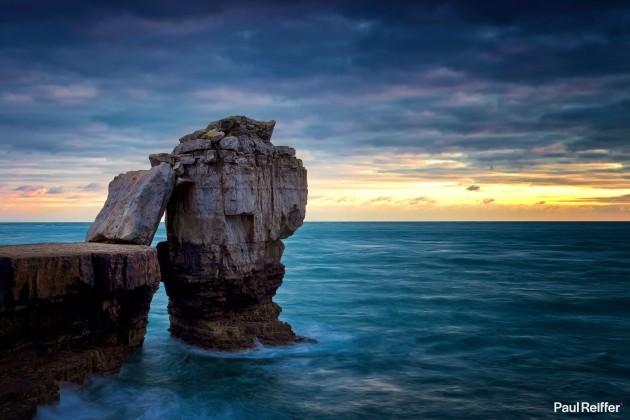 "Location : Dorset, United Kingdom <a href=""https://www.paulreiffer.com/buy-prints/pulpit-rock/"">- Buy the limited edition print</a>"
