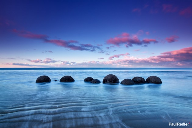 "Location : Moeraki, New Zealand <a href=""https://www.paulreiffer.com/buy-prints/reveal/"">- Buy the limited edition print</a>"